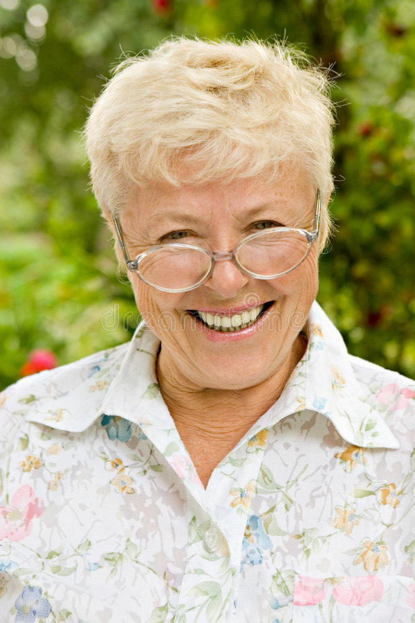 Portrait of the happy grandmother royalty free stock photo