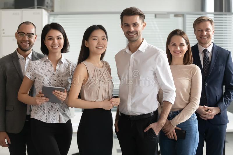 Portrait of happy group of multicultural employees. royalty free stock photo