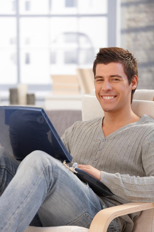 Download Portrait Of Happy Guy With Laptop Computer Royalty Free Stock Photo - Image: 23609315