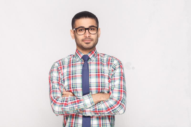 Portrait of happy handsome bearded businessman in colorful check royalty free stock photo