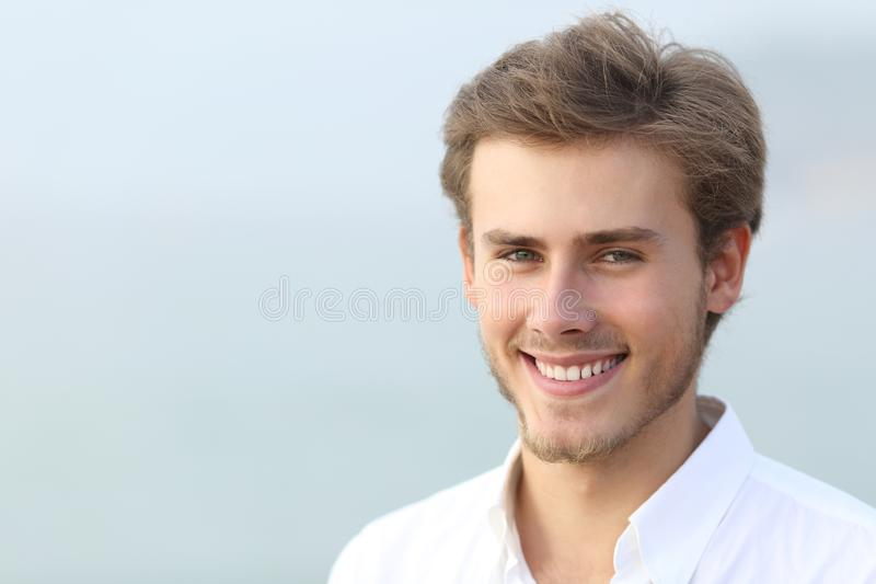 Portrait of a happy man looking at camera on the beach stock photography