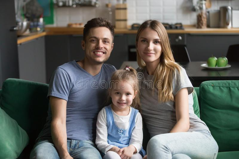 Portrait of happy healthy loving family with kid daughter stock image