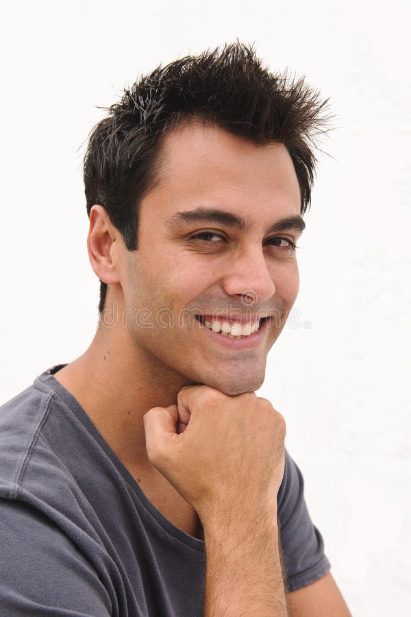 Portrait of a happy hispanic man stock photo