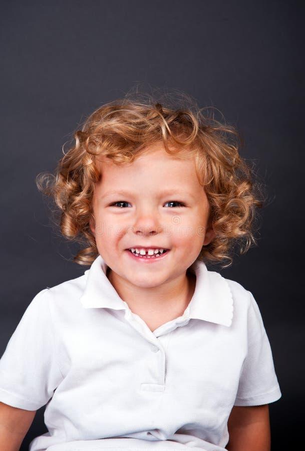 Portrait of happy joyful beautiful little boy royalty free stock photo