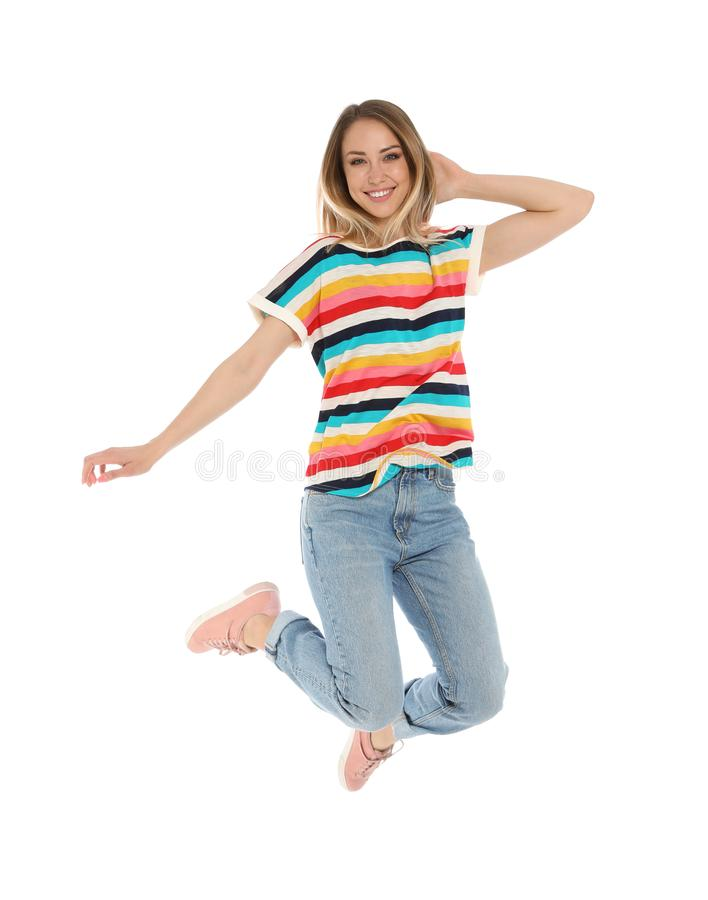 Portrait of happy jumping woman on white royalty free stock photo