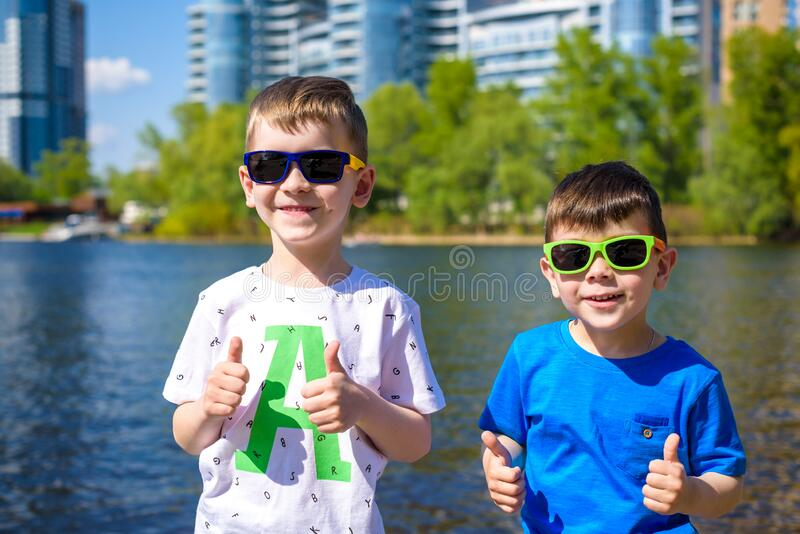 Portrait of happy kids on a bright sunny day. Friendship. Summer holidays royalty free stock image