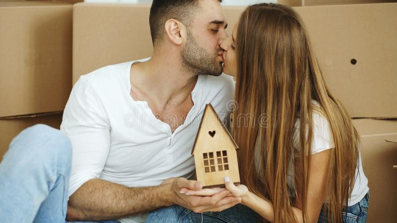 Portrait of happy kissing couple in new home. Indoors stock images
