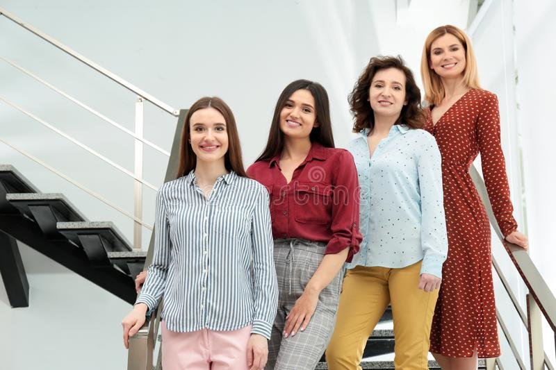 Portrait of happy ladies on stairs. Women power concept royalty free stock photo