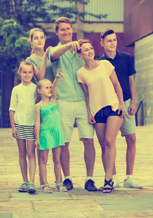 Portrait of happy large family standing pointing with finger tog royalty free stock photo