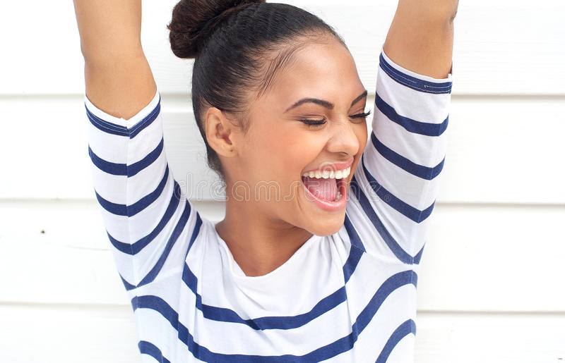 Download Portrait Of A Happy Latin American Smiling With Arms Raised Stock Image - Image: 33872519
