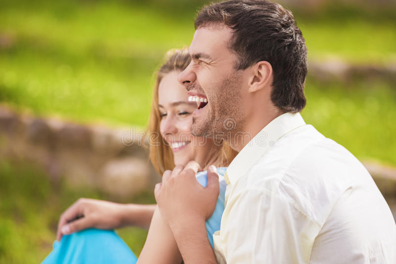 Portrait of Happy Laughing Caucasian Couple Having Fun Outdoors royalty free stock image