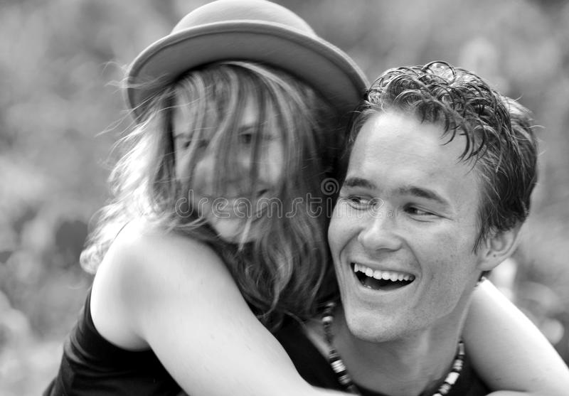 Portrait happy laughing young first love couple. A joyful and intimate portrait of a very joyous young teenage couple who are in love for the first time and