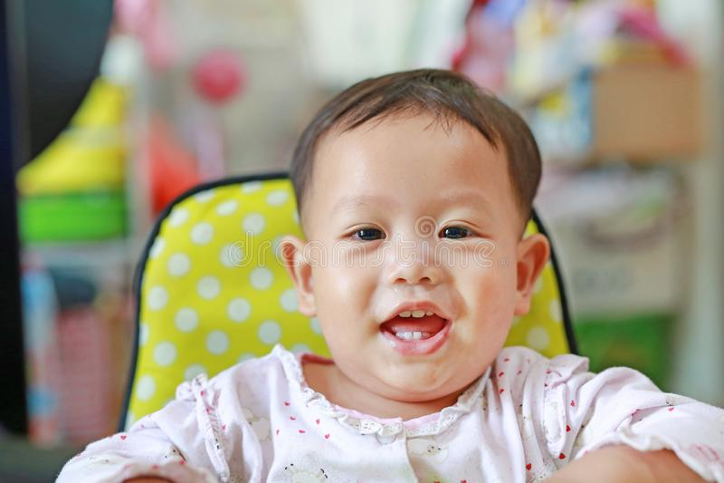 Portrait of happy little Asian baby boy with snot runny nose. Close-up shot royalty free stock photography