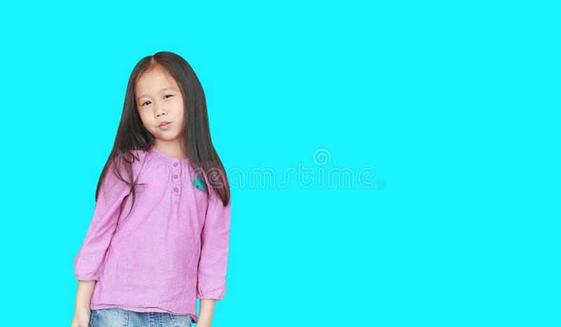 Portrait of happy little Asian child girl isolated on Cyan background with copy space. Kid smiling concept royalty free stock photography