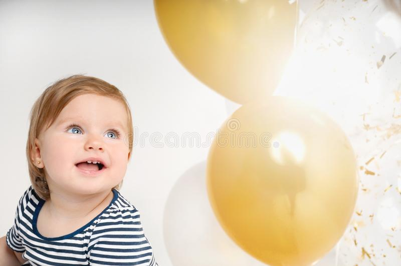 Portrait of happy little baby girl smiling on the day of birth royalty free stock image