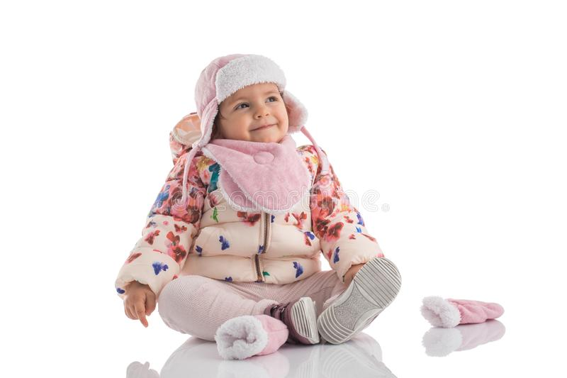 Portrait of happy little baby girl wearing pink winter hat and f royalty free stock images
