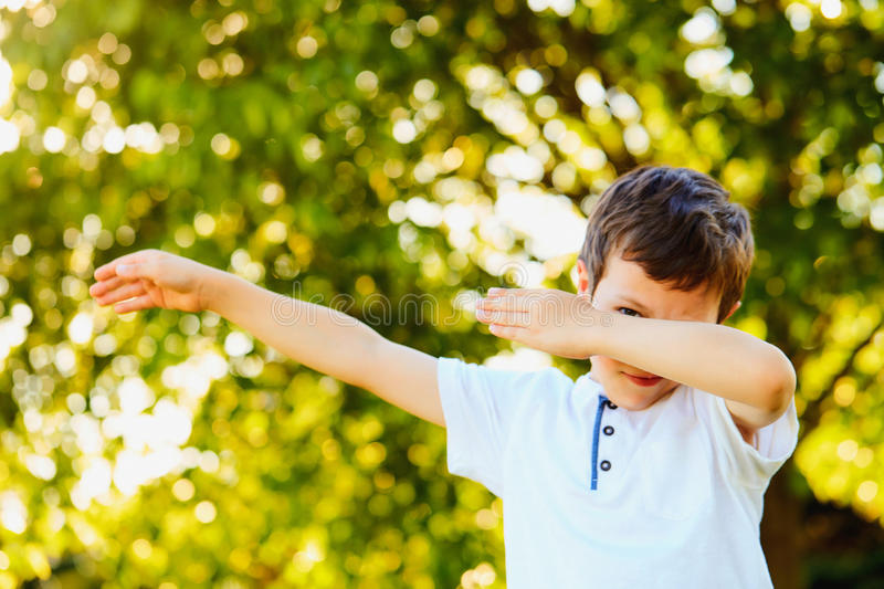 Portrait of happy little boy dancing in summer royalty free stock photo