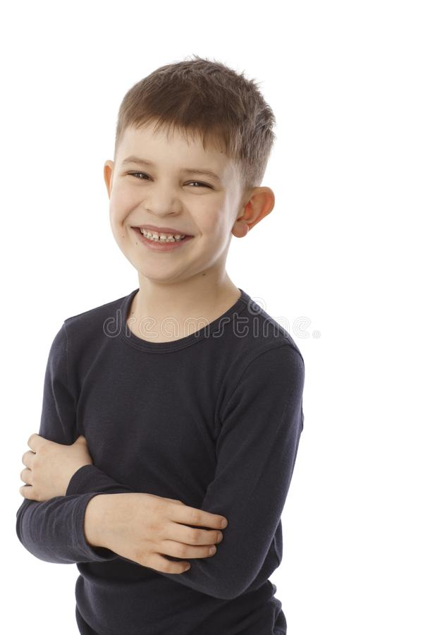 Portrait of happy little boy. Portrait of happy smiling cute little boy standing arms crossed, looking at camera royalty free stock photo
