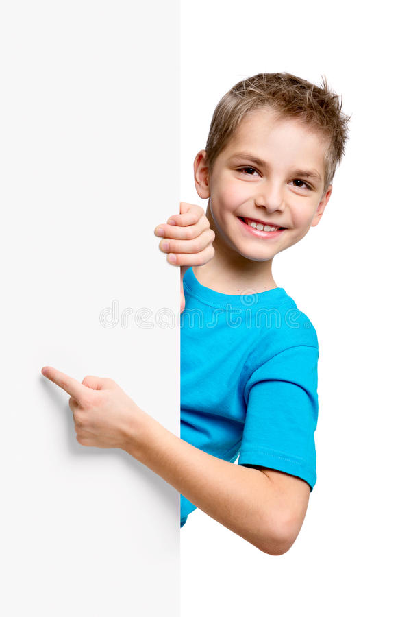 Portrait of happy little boy with white blank stock photography