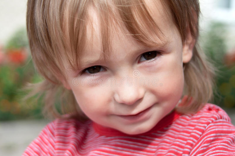 Portrait of a happy little girl stock photos