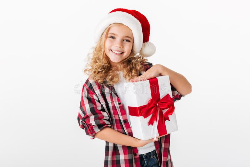 Portrait of a happy little girl holding gift box royalty free stock image