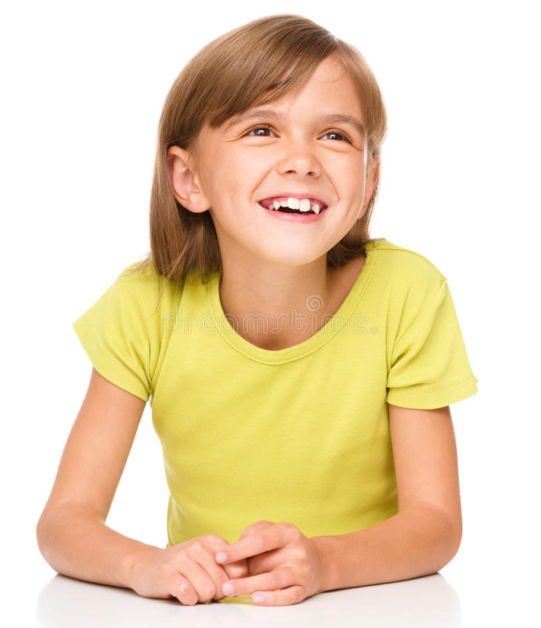Portrait of a happy little girl. Laughing, isolated over white stock image