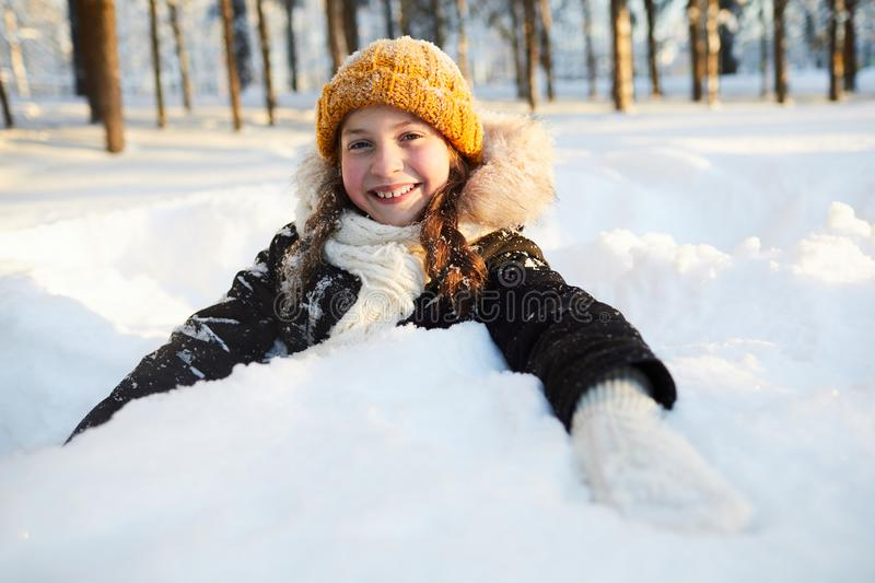 Happy Girl Playing in Snow royalty free stock image