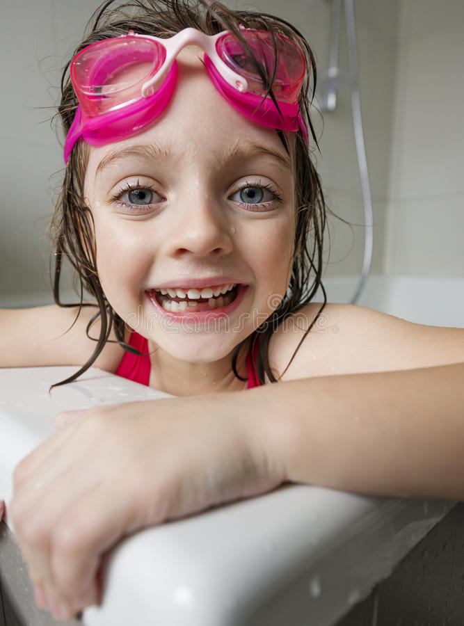 Portrait of a happy little girl with swim glasses royalty free stock photos
