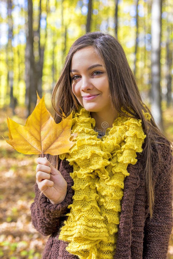 Portrait of happy lovely teenage girl in the forest, autumn sea royalty free stock photography