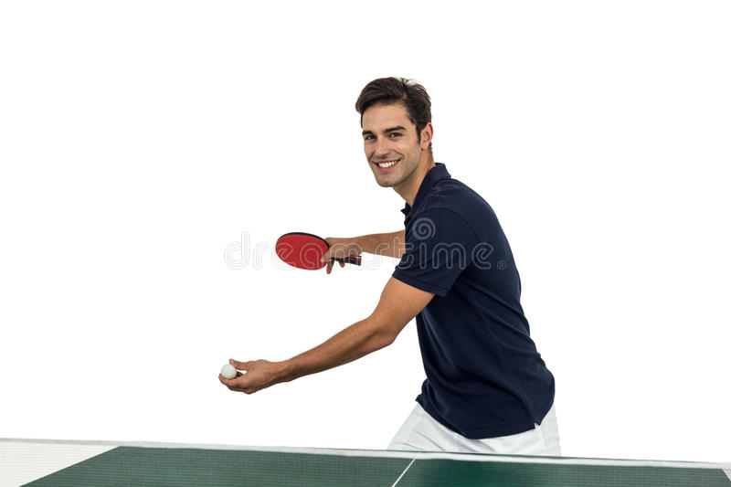 Portrait of happy male athlete playing table tennis. On white background stock photo