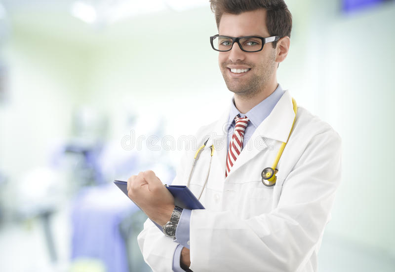 Portrait of happy male doctor with clipboard royalty free stock photos