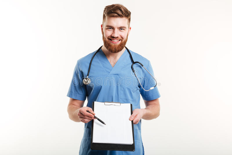 Portrait of a happy male doctor or medical nurse pointing royalty free stock photos