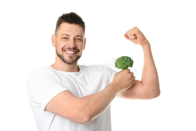 Portrait of happy man with broccoli royalty free stock photography