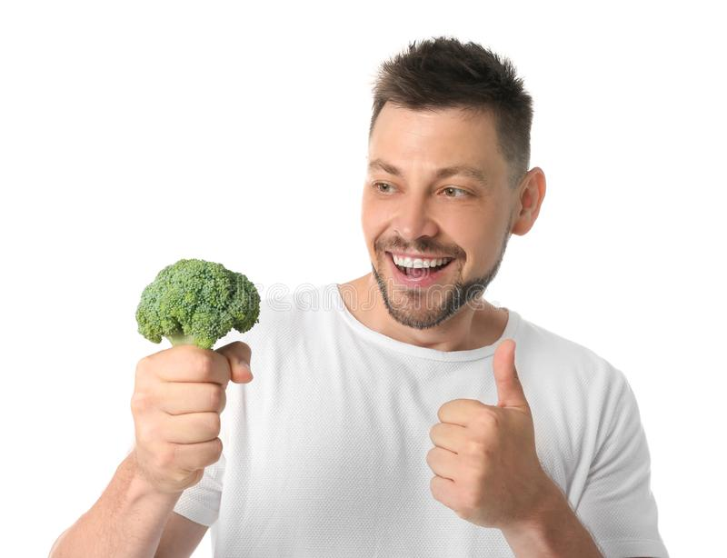 Portrait of happy man with broccoli on white stock image