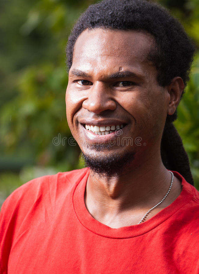 Portrait of happy man from Papua New Guinea royalty free stock images
