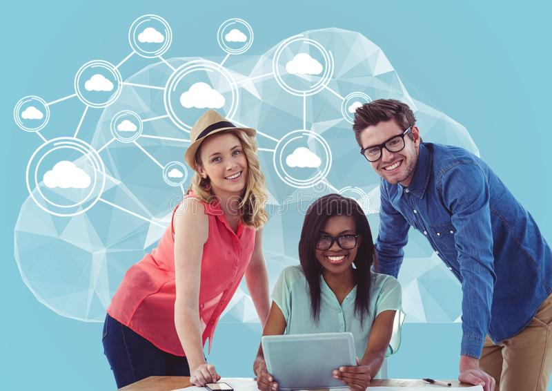Portrait of happy man and women holding laptop with cloud computing concept in background. Digital composition of happy men and women holding laptop with cloud stock photos