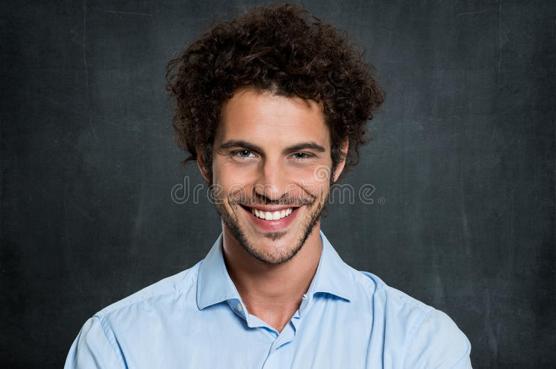 Portrait Of Happy Man. Portrait Of Young Businessman Over Gray Background stock photo