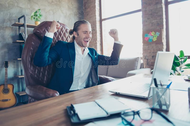 Portrait of happy manager sitting at his desktop in work statio royalty free stock photos