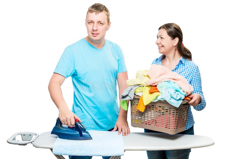 Portrait of a happy married couple while ironing clothes isolate stock photography