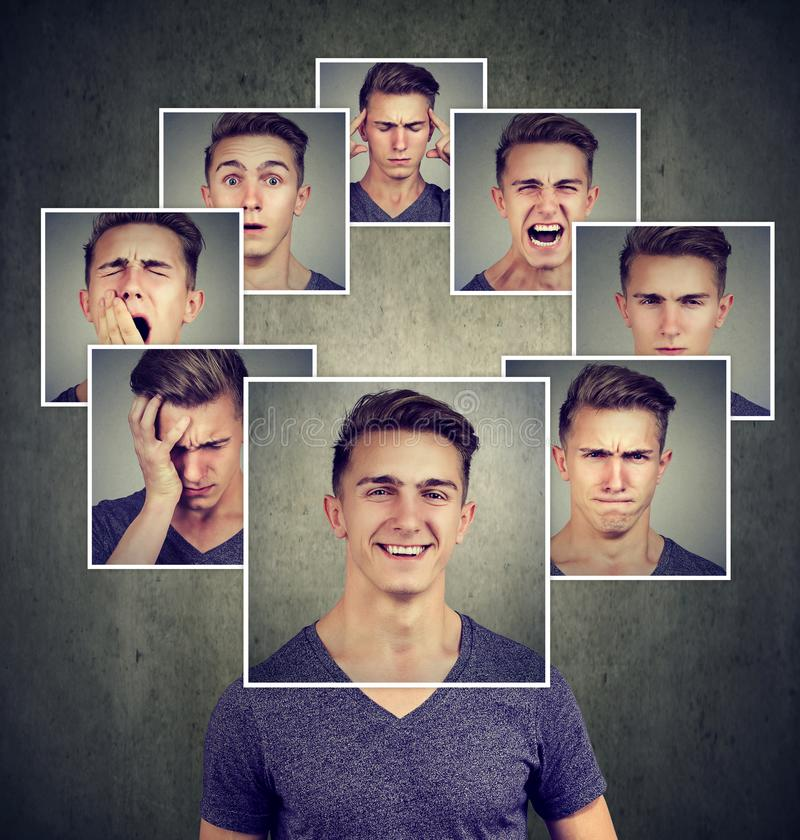Portrait of a happy masked young man expressing different emotions. Portrait of a happy masked man expressing different emotions on gray background stock photo