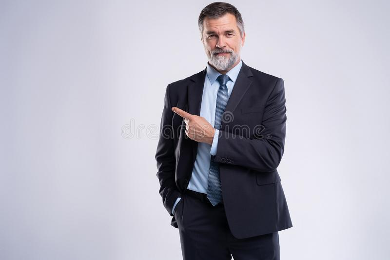 Portrait Of Happy Mature Businessman Presenting Isolated On White Background. stock images