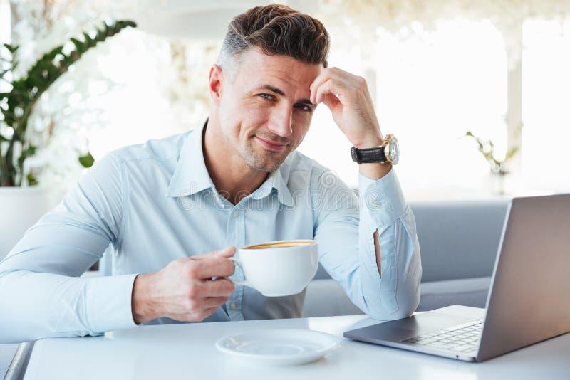 Portrait of a happy mature man using laptop computer stock images
