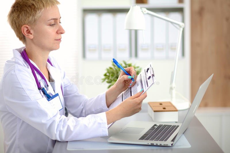 Portrait of happy medical doctor woman in office.  stock images