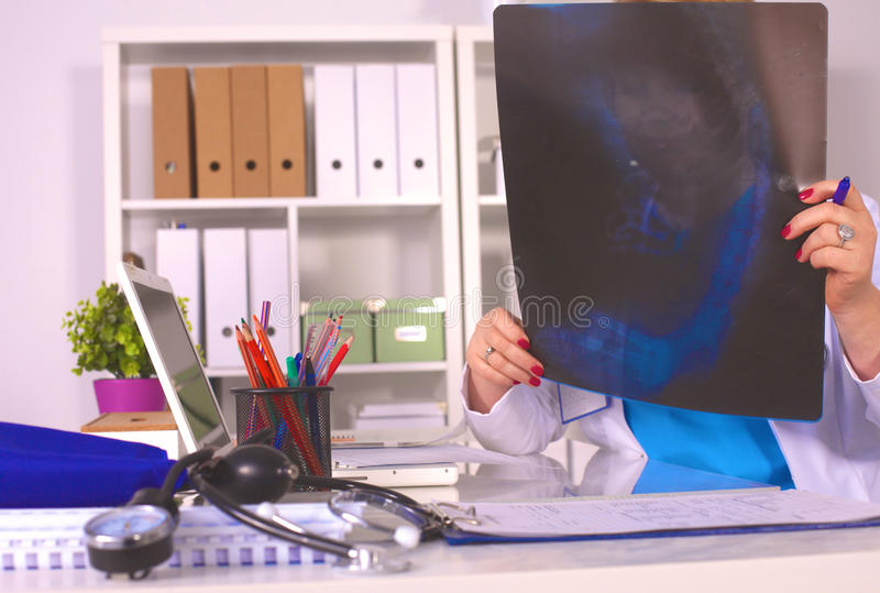 Portrait of happy medical doctor woman in office.  royalty free stock photography