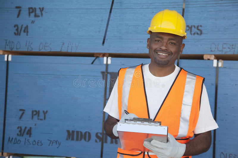 Portrait of a happy mid-adult man working in warehouse stock image