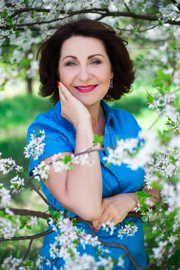 Portrait of happy middle aged woman with healthy skin posing in royalty free stock images