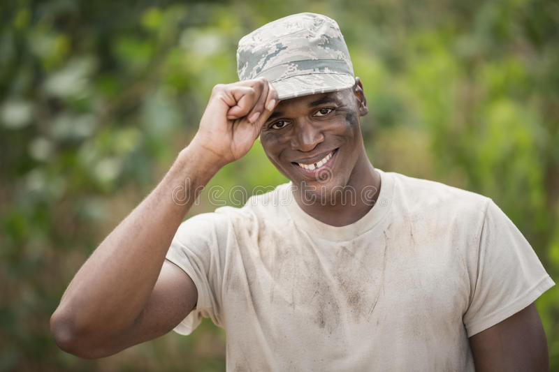 Portrait of happy military soldier holding his cap royalty free stock photo