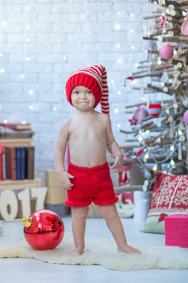 Portrait of happy mother and adorable baby celebrate Christmas. New Year`s holidays. Toddler with mom in the festively decorated r stock photo