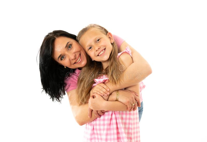 Beautiful young mother and cute charming daughter hugging and playing together. Happy loving family. Portrait of a happy mother and cute blonde little girl stock photos