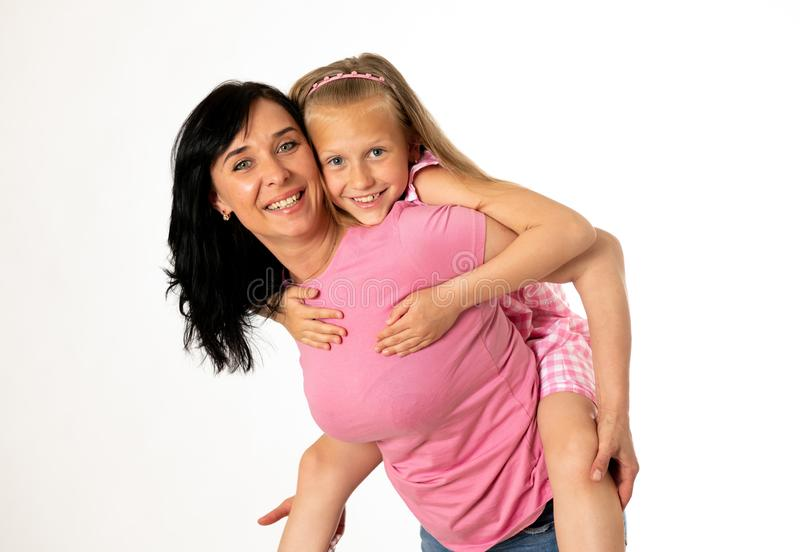 Beautiful young mother and cute charming daughter hugging and playing together. Happy loving family royalty free stock images
